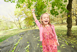 Lifestyle image of a winner girl in park