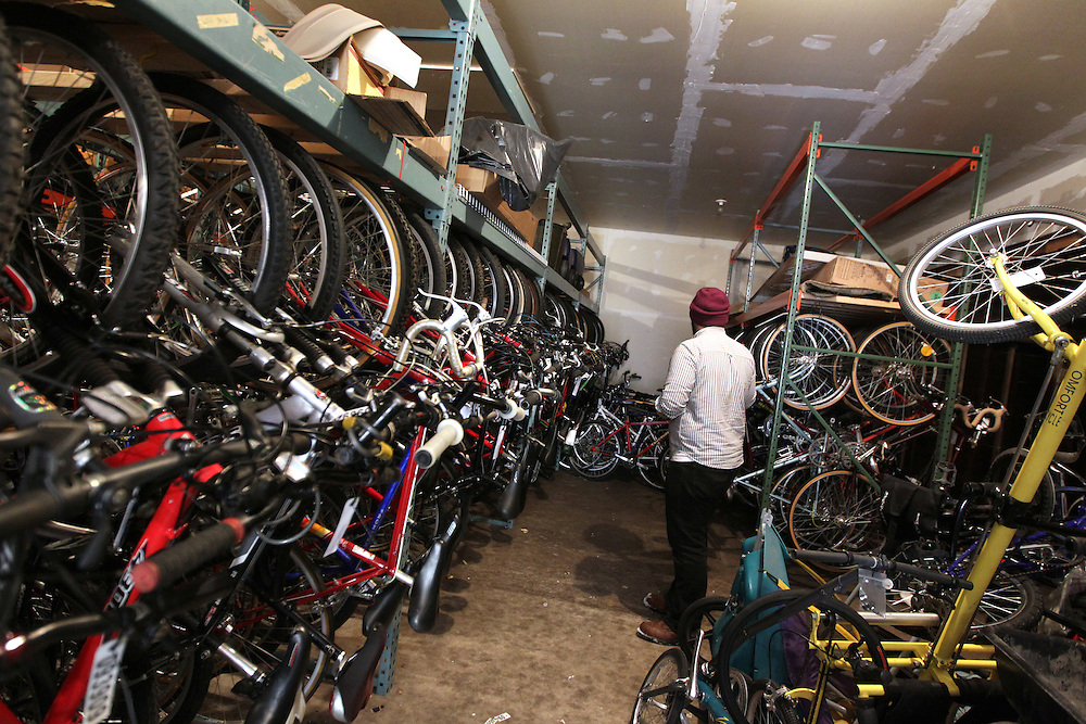 Shop specialist Andrew Dammer, 22, walks through the warehouse of completed refurbished bicycles at Express Bike Shop in St. Paul, Minnesota, February 4, 2013.  The bikes will be sold in the shop, and all proceeds will go towards the funding of the Youth Express program.
