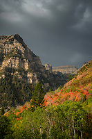 A clearing storm passes by Mt. Timpanogos allowing the evening sunlight to shine through to the brillian Fall colors.