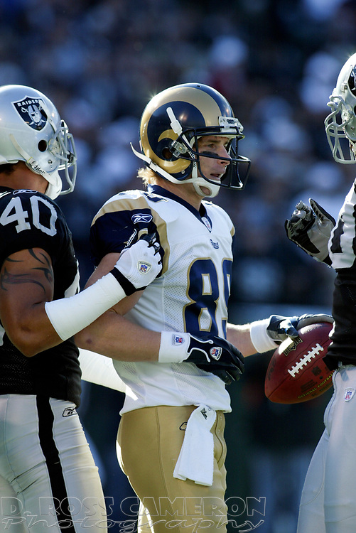 St. Louis Rams punt returner Dane Looker (89) is surrounded by Oakland Raiders after making a fair catch of Shane Lechler's kick, during the first quarter of an NFL football game, Sunday, Dec. 17, 2006 at McAfee Coliseum in Oakland, Calif. The Rams won, 20-0. (D. Ross Cameron/The Oakland Tribune)