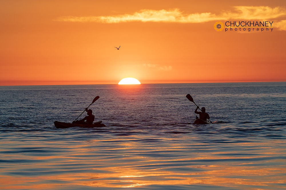 Kayakers in the Gulf of Mexico at sunset off of Captiva Island, Florida, USA