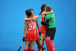 USA's Melissa Gonzalez is dejected with teammate Caitlin van Sickle at the end of the match