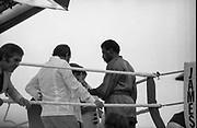 Ali vs Lewis Fight, Croke Park,Dublin.<br /> 1972.<br /> 19.07.1972.<br /> 07.19.1972.<br /> 19th July 1972.<br /> As part of his built up for a World Championship attempt against the current champion, 'Smokin' Joe Frazier,Muhammad Ali fought Al 'Blue' Lewis at Croke Park,Dublin,Ireland. Muhammad Ali won the fight with a TKO when the fight was stopped in the eleventh round.<br /> <br /> Lewis has his glove checked by the cornermen prior to the fight.