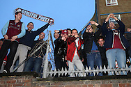 a Crowd of West Ham United fans cheering outside the Boleyn Ground during the 1st half of the match. scenes around the Boleyn Ground, Upton Park in East London as West Ham United play their last ever game at the famous ground before their move to the Olympic Stadium next season. Barclays Premier league match, West Ham Utd v Man Utd at the Boleyn Ground in London on Tuesday 10th May 2016.<br /> pic by John Patrick Fletcher, Andrew Orchard sports photography.