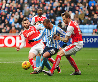 cc20\ vies for possession with Fleetwood Town's Jimmy Ryan, left and Fleetwood Town's Marcus Nilsson, right<br /> <br /> Photographer Andrew Vaughan/CameraSport<br /> <br /> Football - The Football League Sky Bet League One - Coventry City v Fleetwood Town - Saturday 27th February 2016 - Ricoh Stadium - Coventry   <br /> <br /> © CameraSport - 43 Linden Ave. Countesthorpe. Leicester. England. LE8 5PG - Tel: +44 (0) 116 277 4147 - admin@camerasport.com - www.camerasport.com