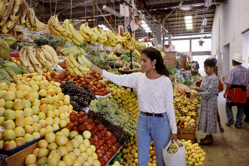 San Miguel del Allende, Mexico: Woman shops for fruits and vegetables at local grocery store in San Miguel del Allende,  <br /> ©Bob Daemmrich/