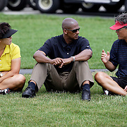 HAVRE DE GRACE, MD, June 5, 2007:  Bo Wie, left, and B.J. Wie, parents of Michelle Wie, talk with Michelle's agent Greg Nared two days before the start of the LPGA Championship in Havre De Grace, MD on June 5, 2007.  (Photo by Todd Bigelow/Aurora)