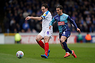Brett Pitman of Portsmouth under pressure from Dominic Gape of Wycombe Wanderers during the EFL Sky Bet League 1 match between Wycombe Wanderers and Portsmouth at Adams Park, High Wycombe, England on 6 April 2019.