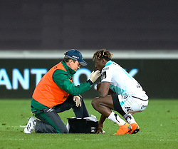 Connacht's Niyi Adeolokun receives medical attention<br /> <br /> Photographer Simon King/Replay Images<br /> <br /> Guinness PRO14 Round 19 - Ospreys v Connacht - Friday 6th April 2018 - Liberty Stadium - Swansea<br /> <br /> World Copyright © Replay Images . All rights reserved. info@replayimages.co.uk - http://replayimages.co.uk