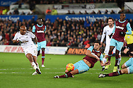 Andre Ayew of Swansea city has a shot at goal blocked by Aaron Cresswell  of West Ham. Barclays Premier league match, Swansea city v West Ham Utd at the Liberty Stadium in Swansea, South Wales  on Sunday 20th December 2015.<br /> pic by  Andrew Orchard, Andrew Orchard sports photography.