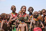 Africa, Ethiopia, Omo Valley, Daasanach tribe a group of women, children  and babies