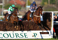 Britanio Bello ridden by jockey Joshua Moore (right) competes in the Strong Flavours Catering Novices Handicap Chase during Injured Jockeys Fund Charity Raceday at Plumpton Racecourse.