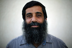 """Morti Moshe, 42, a city hall worker and a 7 year resident of the Gush Katif settlements, is seen in Gaza, Palestinian Territories, Nov. 4, 2004. When asked his thoughts about leaving the settlements and possibly living in a place that is not mortared daily, Moshe responded, """"Wherever you go there are problems. When I was in Jerusalem, every time I took the bus I was so scared. Here, I don't have that problem."""" Israel's parliament recently supported compensation payments for Jewish settlers leaving the Gaza Strip, in a vital vote for Prime Minister Ariel Sharon's plan to evacuate the occupied territory."""