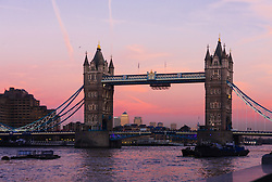 London, November 24th 2014. With London having enjoyed a clear if cold day, weather forecasters are predicying a cold night with temperatures expected to dip as low as 3 degrees in the early hours of Tuesday. PICTURED: The evening sky turns pink behind Tower Bridge.
