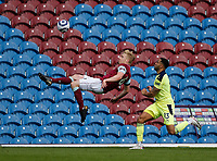 Football - 2020 / 2021 Premier League - Burnley vs. Newcastle United<br /> <br /> Ben Mee of Burnley clears his lines with an overhead kick as Callum Wilson of Newcastle United challenges, at Turf Moor.<br /> <br /> <br /> COLORSPORT/ALAN MARTIN