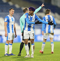 Huddersfield Town's Juninho Bacuna appeals for a handball decision after Reading's Michael Morrison appeared to block a strike from Huddersfield Town's Jonathan Hogg with his arm<br /> <br /> Photographer Rich Linley/CameraSport<br /> <br /> The EFL Sky Bet Championship - Saturday 2nd January 2021 - Huddersfield Town v Reading - The John Smith's Stadium - Huddersfield<br /> <br /> World Copyright © 2020 CameraSport. All rights reserved. 43 Linden Ave. Countesthorpe. Leicester. England. LE8 5PG - Tel: +44 (0) 116 277 4147 - admin@camerasport.com - www.camerasport.com