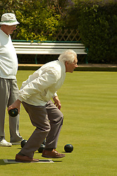 © London News Pictures. 23/05/2006. Members enjoy the Kent spring sunshine as Britain's bowling greens are under threat by property developers and councils looking to cut costs and raise funds. Hythe Bowling Club in Kent is managing to survive with a combined associated membership of over 900. Photo credit should read Manu Palomeque/London News Pictures