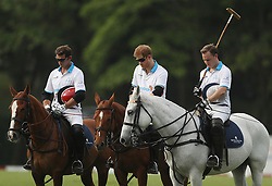 Prince Harry (centre) observes a one minute silence for the London terrorist attack, as he takes part in the Sentebale Royal Salute Polo Cup at the Singapore Polo Club.