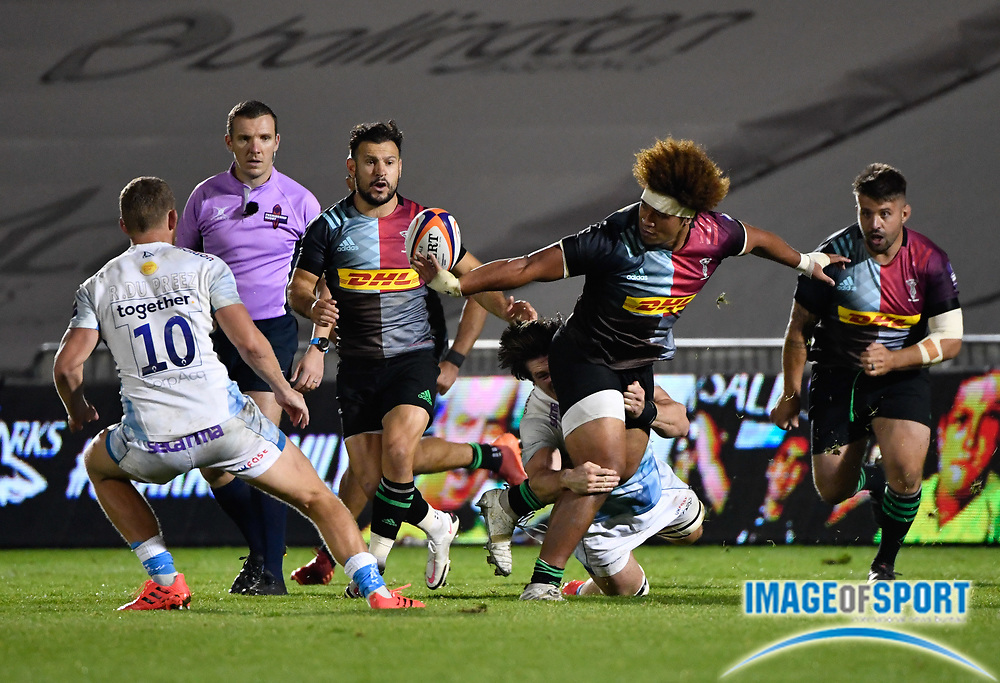 Harlequins Elia Elia off-loads the ball to scrum-half Danny Care during The Premiership Rugby Cup Final at The AJ Bell Stadium, Eccles, Greater Manchester, United Kingdom, Monday, September 21, 2020. (Steve Flynn/Image of Sport)