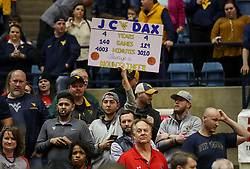 Feb 26, 2018; Morgantown, WV, USA; A West Virginia Mountaineers fan holds up a sign honoring West Virginia Mountaineers guard Jevon Carter (2) and West Virginia Mountaineers guard Daxter Miles Jr. (4) last game in the WVU Coliseum. Mandatory Credit: Ben Queen-USA TODAY Sports