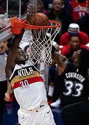 December 31, 2018 - New Orleans, LA, U.S. - NEW ORLEANS, LA - DECEMBER 31:  New Orleans Pelicans forward Julius Randle (30) dunks the ball abasing Minnesota Timberwolves forward Robert Covington (33) at New Orleans Arena in New Orleans, LA on Oct 23, 2018.  (Photo by Stephen Lew/Icon Sportswire) (Credit Image: © Stephen Lew/Icon SMI via ZUMA Press)
