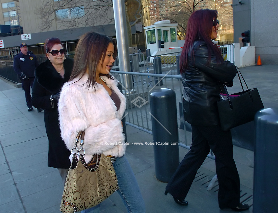 Victoria Gotti, left, mother of John Gotti Jr., Angel Gotti, right, sister, and unconfirmed/unidentified family member, center, walk into court for the trial of John Gotti Jr at 500 Pearl Street in Manhattan Wed. March 1, 2006.