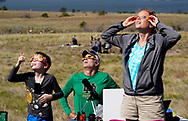 People watch the total solar eclipse in Guernsey, Wyoming U.S. August 21, 2017.  REUTERS/Rick Wilking