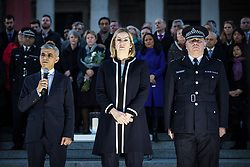 © Licensed to London News Pictures. 23/03/2017. London, UK. Mayor of London Sadiq Khan (L), Home Secretary Amber Rudd (centre) and Metropolitan Police Deputy Commissioner Craig Mackey (R) join thousands of people at a vigil in Trafalgar Square for the victims of the Westminster terrorist attack, which took place on 22 March 2017. Photo credit: Rob Pinney/LNP