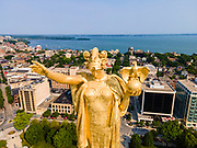 Photograph of the Forward statue on the top of Wisconsin's State Capitol Building on a beautiful summer morning. The top of the statue is the highest point in Madison. Madison, Wisconsin, USA.