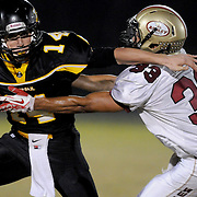 """Topsail's Nick Altilio rushes agaings Ashley's Anthony Boone. (Jason A. Frizzelle) After graduating from Randolph Community College I spent more than a decade documenting communities throughout Eastern North Carolina with a camera. My passion for capturing story-telling images has allowed me to witness everything from High School Football to Hurricanes and even Presidential visits.<br /> <br /> My award-winnng photography has been published internationally, appearing in publications such as The Atlanta Journal Constitution, The Los Angeles Times, USA Today, The Guardian of London, and Time Magazine.<br /> <br /> As a child I loved the writing of Ray Bradbury, who was often noted for """"tuning the ordinary into the extraordinary."""" That's the approach I take to every assignment, finding the priceless moments in everyday life. Weather I'm capturing a high school touchdown celebration or a bride's final minutes before saying """"I do,"""" I'm preserving an extraordinary memory.<br />             <br /> Whether I'm documenting a diverse community or capturing a couple's first dance, I'm photographing something extraordinary!"""