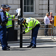 Bomb disposal checking at the lamp post before the International Day of United Nations Peacekeepers - Remembrance Ceremony, on 23 May 2019, London, UK.