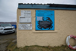 The Ulva ferry summon board. Feature on the community on the island of Ulva, who have been awarded £4.4m in funding for their island buyout.