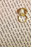 Wedding Concept two wedding bands on a Jewish Ktubah