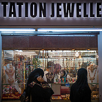 Ladies shopping at the Muttrah Souk in Muscat, Oman. Because of the hot desert climate, most shopping and walking is done in the cooler night hours.