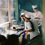 Chefs preparing food, Silk Route, Turpan, Xinjiang Province, China.