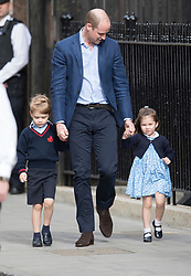 © Licensed to London News Pictures. 23/04/2018. London, UK. PRINCE WILLIAM leads Prince George and Princess Charlotte in to visit THE DUCHESS OF CAMBRIDGE in the Lindo Wing at St Mary's Hospital in London. The Duchess gave birth to a baby boy earlier today. Photo credit: Peter Macdiarmid/LNP