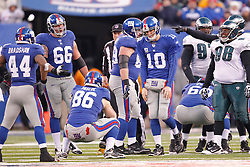 New York Giants quarterback Eli Manning #10 walks with his head down during the NFL Game between the Philadelphia Eagles and the New York Giants.  The Eagles won 38-31 at The New Meadowlands Stadium in East Rutherford, New Jersey on Sunday December 19th 2010. (Photo By Brian Garfinkel)