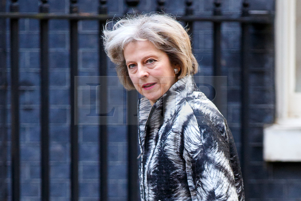 © Licensed to London News Pictures. 13/10/2015. London, UK. Home Secretary THERESA MAY attending to a cabinet meeting in Downing Street on Tuesday, 13 October 2015. Photo credit: Tolga Akmen/LNP