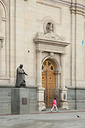 Woman walking past Metropolitan Cathedral, Santiago, Chile