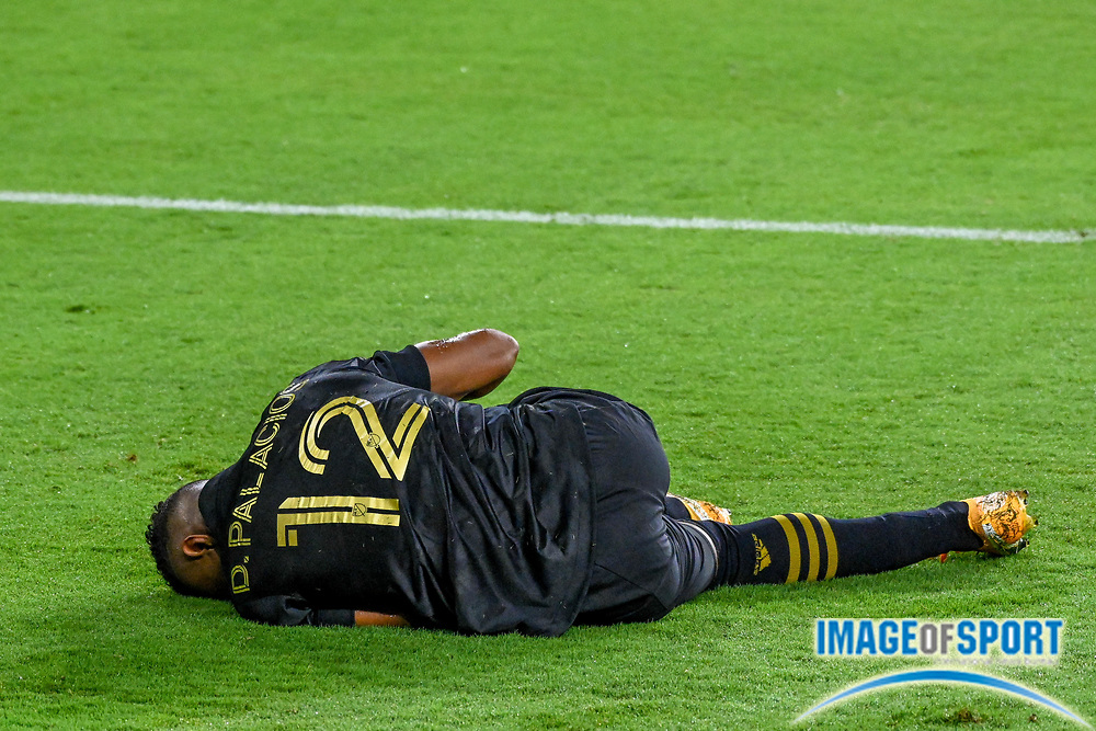 LAFC defender Diego Palacios (12) lay on the ground during a MLS soccer game, Sunday, Sept. 27, 2020, in Los Angeles. The San Jose Earthquakes defeated LAFC 2-1.(Dylan Stewart/Image of Sport)