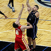 ORLANDO, FL - MARCH 03: Nikola Vucevic #9 of the Orlando Magic attempts a shot over Danilo Gallinari #8 of the Atlanta Hawks during the first half at Amway Center on March 3, 2021 in Orlando, Florida. NOTE TO USER: User expressly acknowledges and agrees that, by downloading and or using this photograph, User is consenting to the terms and conditions of the Getty Images License Agreement. (Photo by Alex Menendez/Getty Images)*** Local Caption *** Nikola Vucevic; Danilo Gallinari