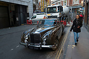 Vintage Rolls Royce car parked in a back street in the City of London, England, United Kingdom.