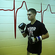"""Luis Olivares gets ready in the locker area during the """"Boxeo Telemundo"""" boxing match at the Kissimmee Civic Center on Friday, March 14, 2014 in Kissimmme, Florida. (Photo/Alex Menendez)"""
