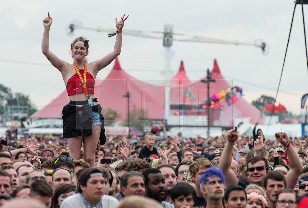 © Licensed to London News Pictures. 29/08/2015. Reading Festival, UK. Festival goers watch Royal Blood perform at Reading Festival 2015, Day 2.  Photo credit: Richard Isaac/LNP