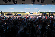 Crowds cheer as Air Force One arrives before President Donald Trump's campaign rally at North Star Aviation in Mankato, Minnesota on Monday, Aug. 17, 2020.