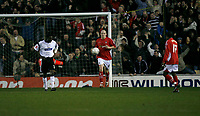 Lee McEvilly of Wrexham collects the ball after scoring Wrexhams goal following a defensive error