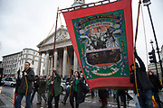 London, UK. Saturday 13th April 2013. Banner for the National Union of Mineworkers is paraded towards the Margaret Thatcher Death Party in Trafalgar Square, to celebrate the late Prime Minister's passing away.