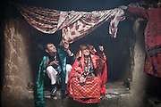 Young married couple in Tchelekand village, inhabited by Wakhis people. ..Driving down from Sarhad village, end of the road in the Wakhan corridor, to Ishkashim town, on the Tajikistan border.