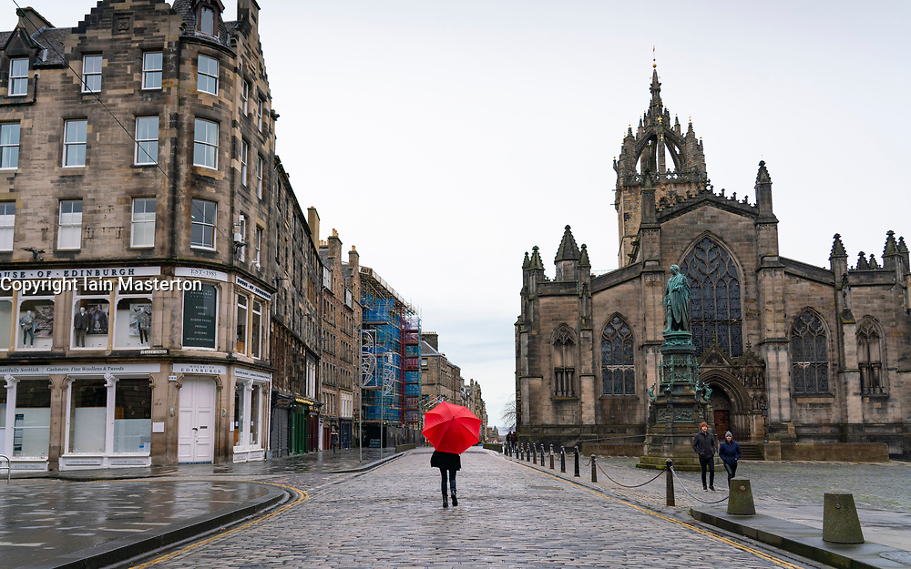 Edinburgh, Scotland, UK. 26 December 2020. Scenes from Edinburgh City Centre on a wet and windy Boxing Day during storm Bella. Today is first day that Scotland is under level 4 lockdown and all non essential shops and businesses are closed. As a result the streets are almost deserted with very few people venturing outside. Iain Masterton/Alamy Live News