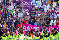 """© Licensed to London News Pictures . 29/09/2013 . Manchester , UK . A Unison lead demonstration titled """" Save our NHS """" through Manchester City Centre today (Sunday 29th September 2013) coinciding with the Conservative Party Conference in the city . Photo credit : Joel Goodman/LNP"""
